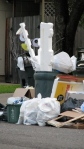 Styrofoam stuffed into garbage cans. A sure sign the economy is on the mend.