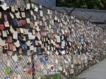 Ceramic tiles paying tribute to those who lost their lives in the Towers. The fence is across the street from St. Vincent's Hospital.